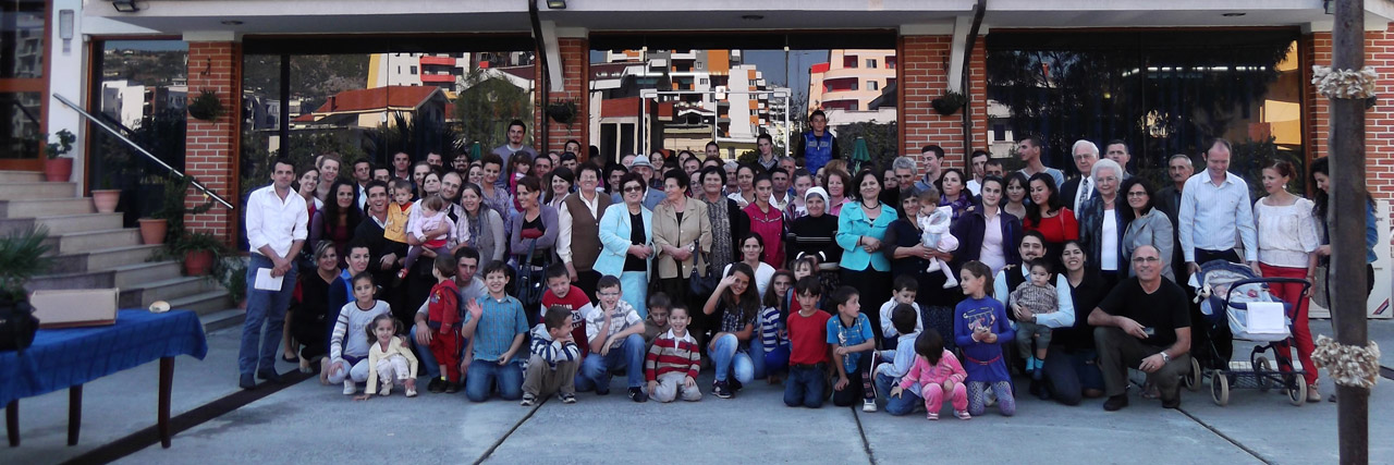 A community of faith gathers after a worship service in Lezhe, Albania, in front of the Lezha Academic Center building.