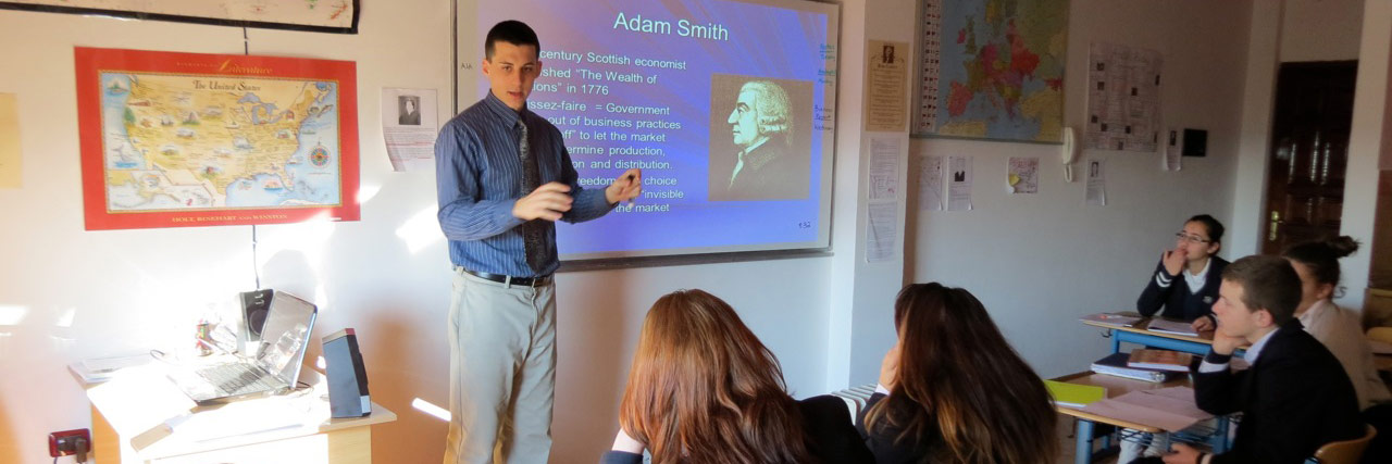 Caleb Benner teaches an Economics class at Lezha Academic Center, Albania. 'We believe that we have been called to make an impact on the spiritual life of each student,' he writes.