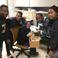 Eve, Benjamin, and Natacha, teenaged refugees from DR Congo, helped the author distribute cookies to Sentara RMH employees working on Christmas Eve. Photo courtesy of Ben Emswiler