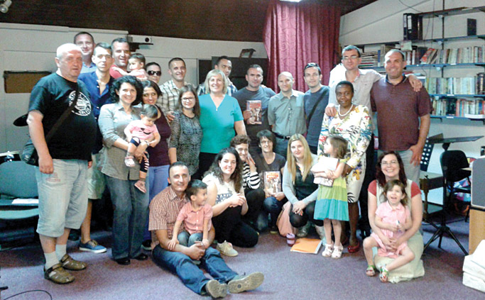 The church in Podgorica that Steve and Laura relate to. A number of people pictured have been engaged in discipleship training, including Lazar (seated, holding his son Jacob) and his wife Masha (standing above Lazar, with glasses). Photo courtesy of Steve Campbell