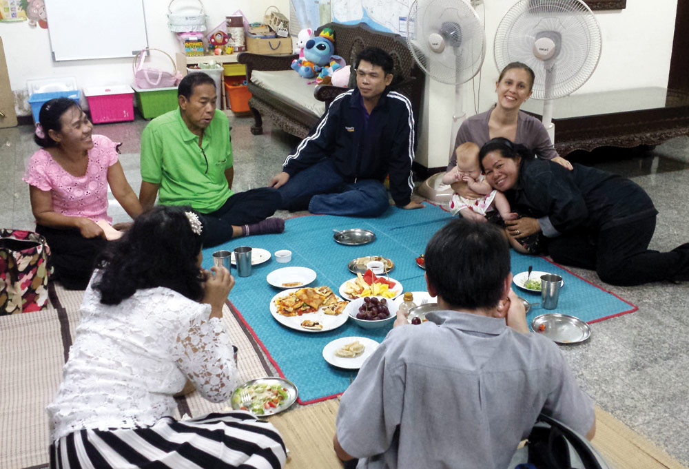 Steve and Bethany's Isaan friends help with evangelism efforts to share the Good News with other Isaan people over pizza at the Horst's home in Bangkok. Photo by Steve Horst