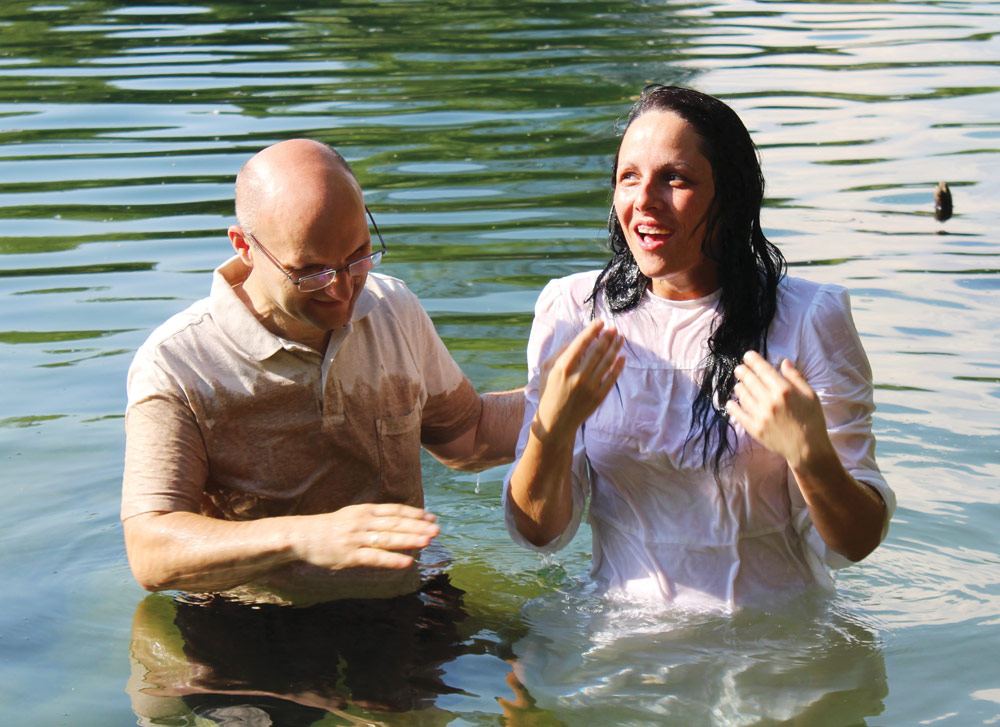 "Pastor Vladimir Cizmanski baptizes Gordana ""Gotza"" Deki Sedlak into the family of God. Photo: Lazar Atanasovski"