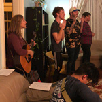 College students worship in the living room of 264 OSH, a hospitality ministry called Eastside College that invites students into a growing relationship with God.