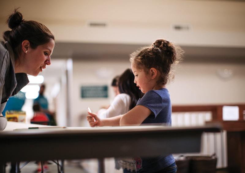 Kids Club volunteer Elizabeth Ochoa interacts with Emily  at Park View Mennonite Church. Photo courtesy of Seth Crissman