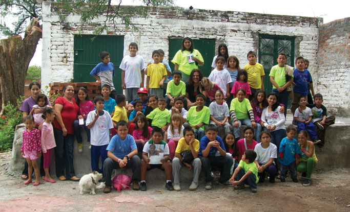 Manantial de Vida mission trip participants with children at VBS in Colotlan, Mexico.