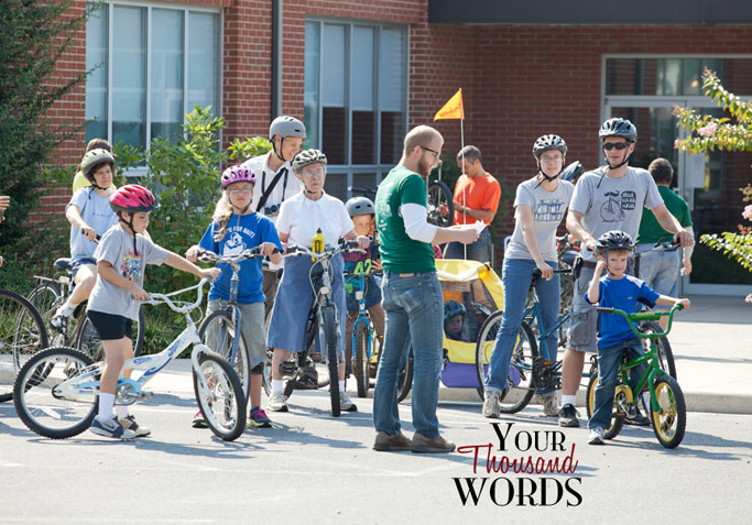 Eric Trinka (center) gets Bike Shenandoah riders ready for the five-mile family ride. There were five rides: 100 miles, 62, 30, 15, and 5 miles.  Photo by Mary Eicholtz / Your Thousand Words Photography