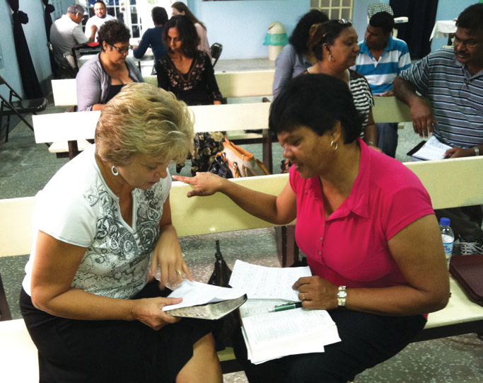 Bev Scaggs and Babes Jaimani discuss topics raised in the leadership classes held in the Charlieville Mennonite Church.