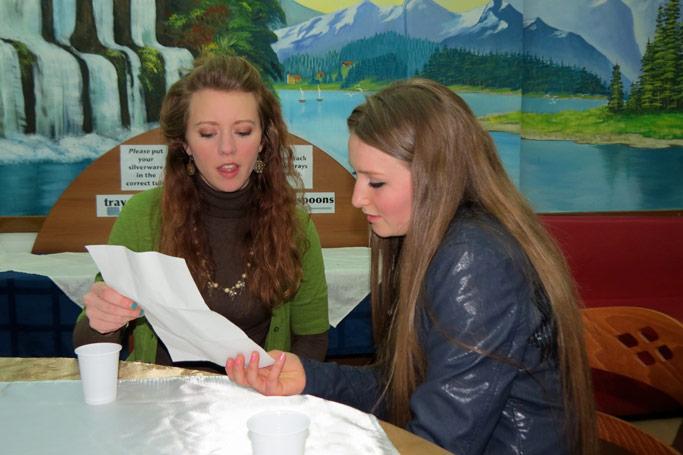 A senior showed her teacher, Jessica Hedrick, VMM worker at LAC, (left)  her letter of acceptance from Eastern  Mennonite University.