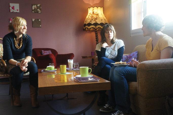 Rebekka Stutzman meets over coffee with friends.