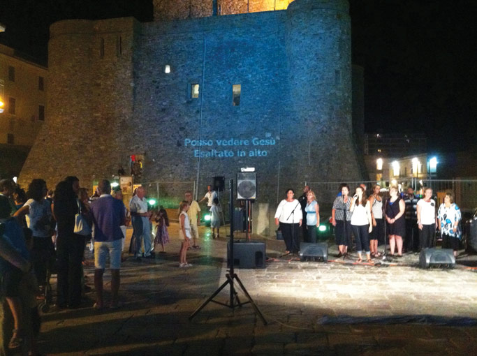 The Vasto church shares the Good News with open-air evangelism in the evenings.