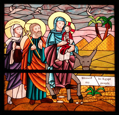 """""""Holy family window""""—This is a typical stained-glass representation of the holy family traveling through Egypt. One tradition holds that Salome accompanied them. It comes from the Church of St. Mina in Beni Suef."""