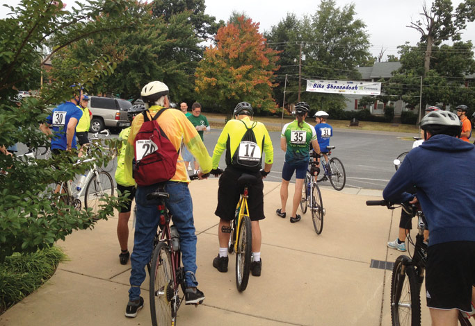 Riders receive instructions just prior to their ride on September 21. Riders could choose between five route lengths, from a five-mile family ride to a 100-mile ride. Photo by Lori Doll