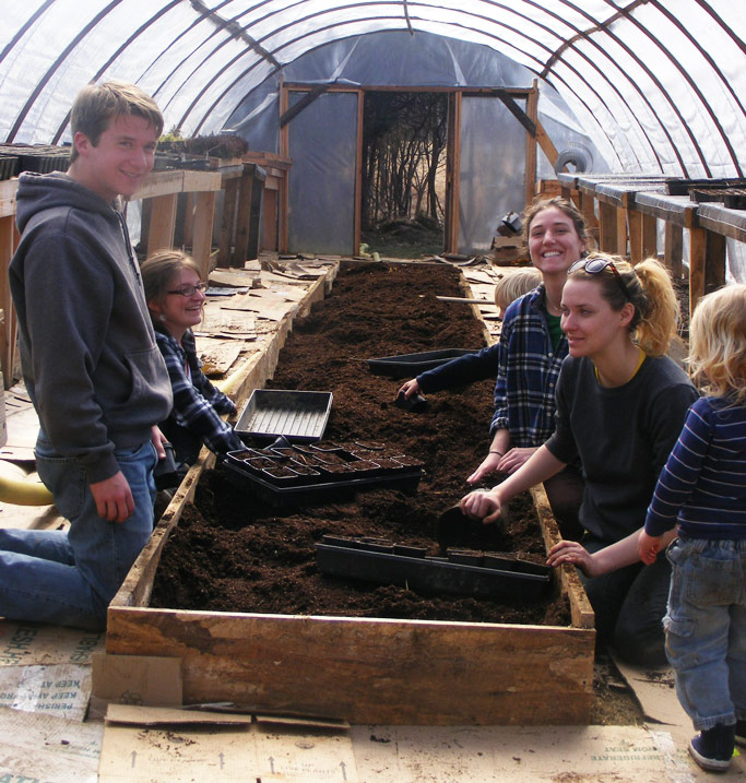 Friends enjoy planting seeds in the OCF greenhouse. Photos courtesy of author