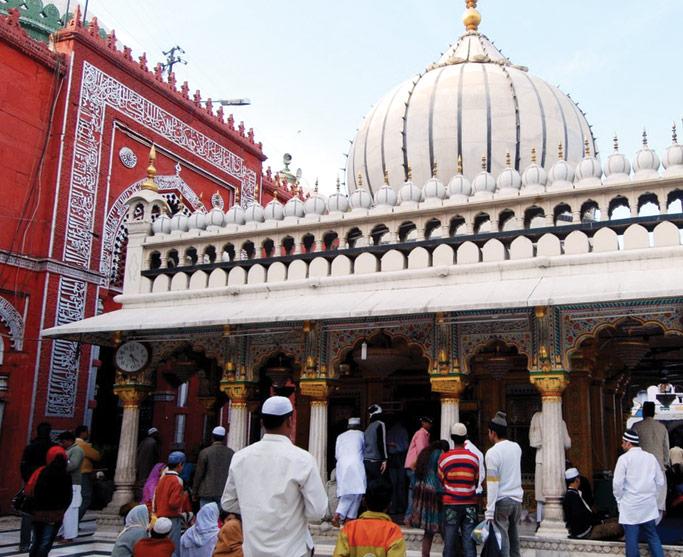 Muslim pilgrims gather at a shrine holy to Islam. Courtesy of authors