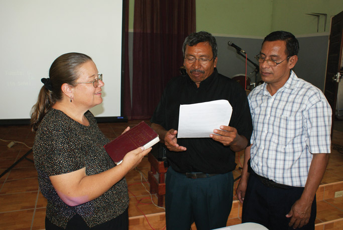 Nancy Marshall with Fernando Blanco, president of the Belize Evangelical Mennonite Church, and Tomás Torres, lay leader, during her ordination service. Photo: Galen Lehman
