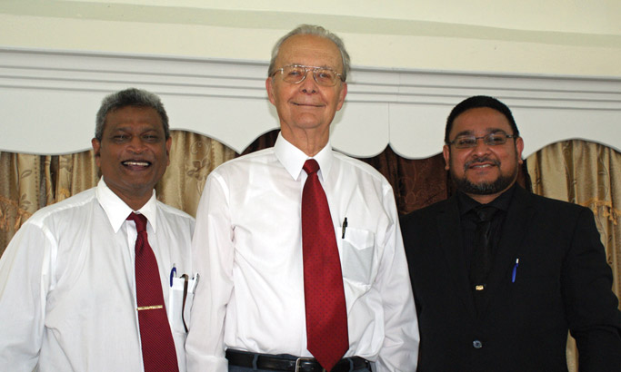 Ganese Gunpath, MCTT overseer (left) and Navin Benny, pastor of Hope Mennonite Church (right) stand beside Paul Kniss,  whose spiritual nurture and financial support brought into fruition the Hope Mennonite Church, both in its physical building and in its development as a congregation. Photo by Galen R. Lehman