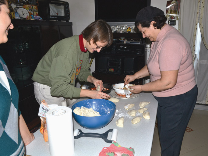 Melody and Ines prepare panzarotti, a type of filled pastry, for a New Year's celebration with the family of Luigi and Elena. Photo: Chris Riddle