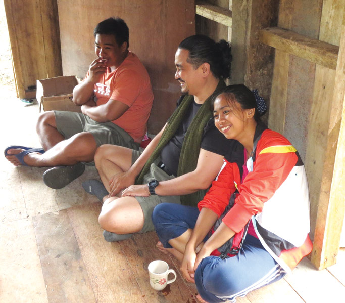 Twinkle (right) in Kalinga with her mission mentor Rev. Daniel Pantoja (center), during a time of fellowship with her newly-organized mission community.  Photo: Bryan Jay Nahag Paler