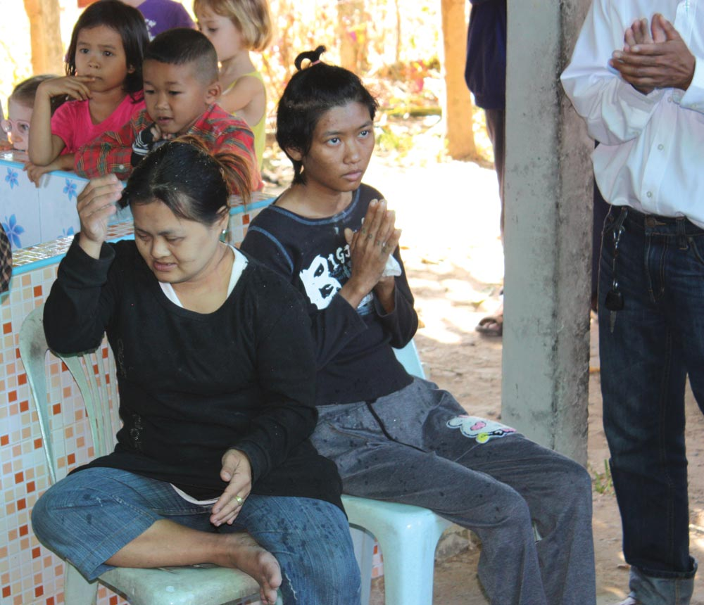 Ying (with praying hands) at her baptism in December.