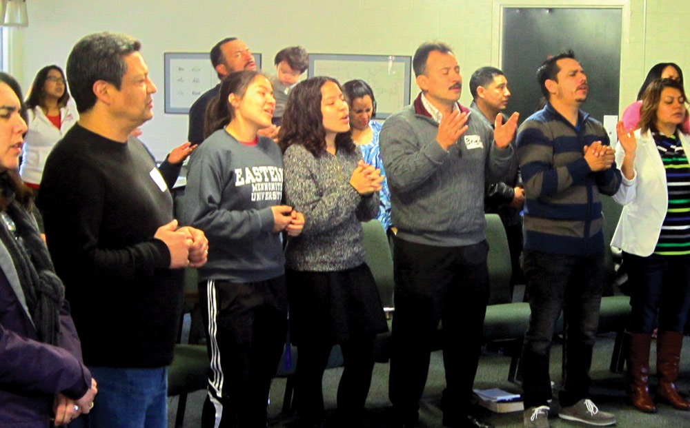 Participants at a Mennonite Hispanic Initative retreat join their voices in praise during a worship service.  Photo courtesy of Marvin Lorenzana