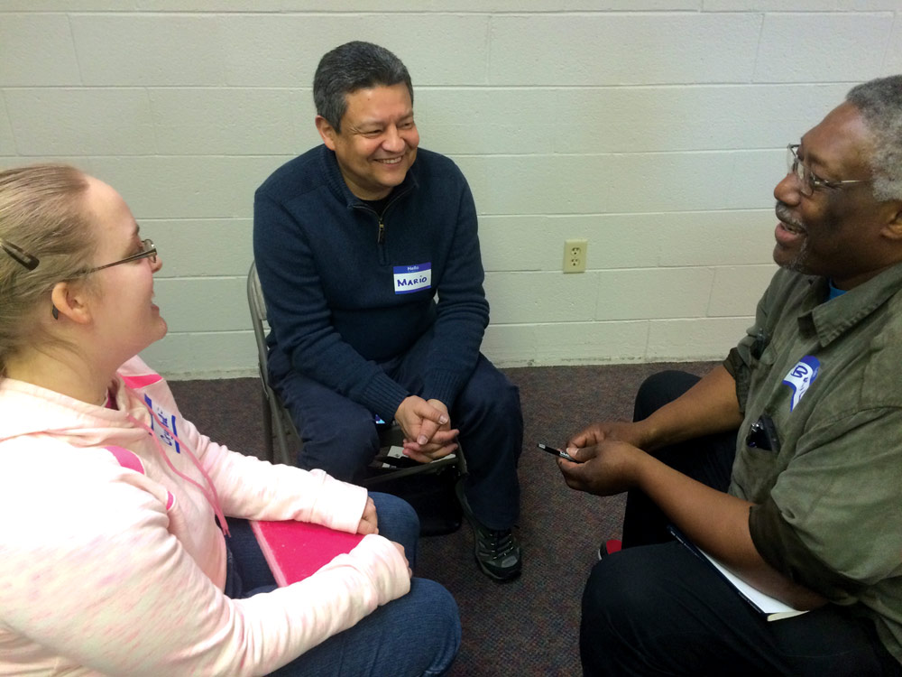 Crystal Lehman, Mario Hernandez and Basil Marin  participate in a Life Transformation Groups workshop. Photo courtesy of Lizzette Hernandez