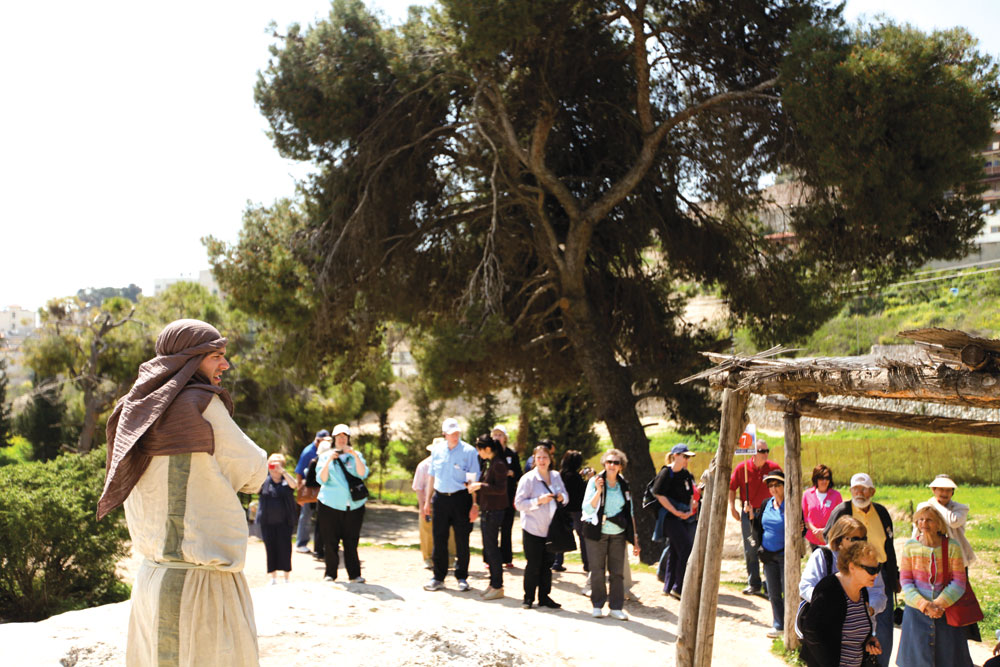 A guide in first century clothing shares stories from the life and times of Jesus at  Nazareth Village. Photo courtesy of Elsa Miller