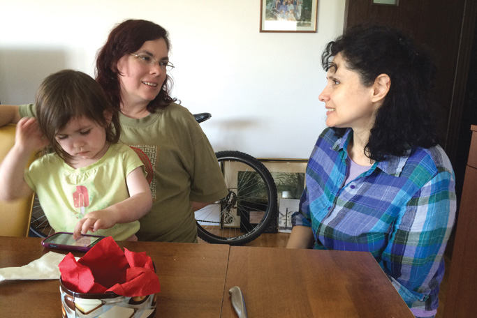 Laura Campbell, the author's wife, with daughter Esther, talks with Marijana Cizmanski. Serving on the church  leadership team with Vladimir and Marijana, the Campbells use their gifts for discipleship ministry. Photo by Janet Blosser