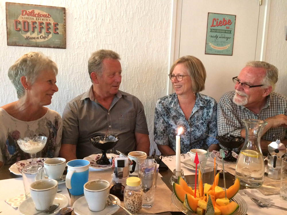 Esther and Don Clymer (right) share coffee time with Swiss friends Walter and Regina. Photo courtesy of author