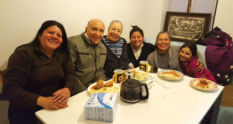 The Machados enjoy a lunch of pupusas and chicken with fellow Hondurans from the home group which meets on  Saturdays. From left is María Elena, Francisco and Juanita Machado, Arely, Francisca, and Martha, a girl from Spain.  Courtesy of Francisco Machado