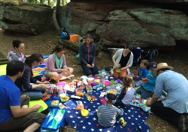 """Friends and neighbors of Rebekka Stutzman (center) and David were invited to go hiking, with a picnic lunch. """"We try to naturally include people into the activities of our community life,"""" said David. Photo: David Stutzman"""