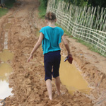 Maia, daughter of VMMissions workers J and H, walks through thick mud with her family to reach the home of a Rohingya family that had fled Myanmar.