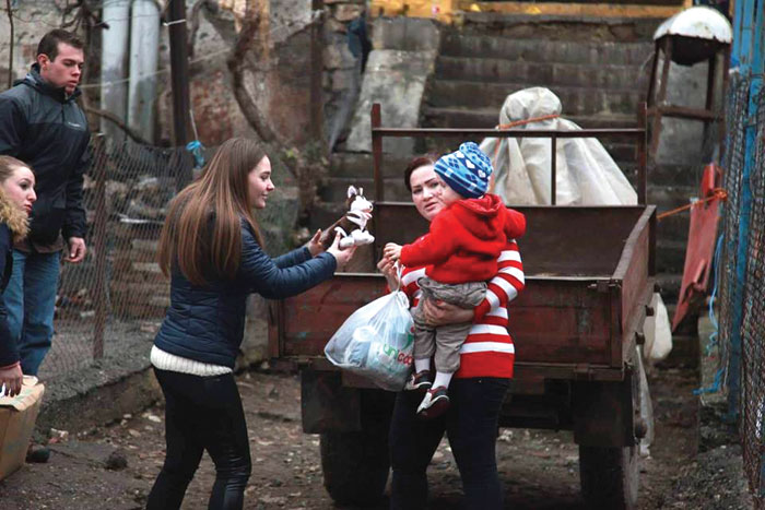 LAC students distribute supplies to families in Lezhë as part of a service project.