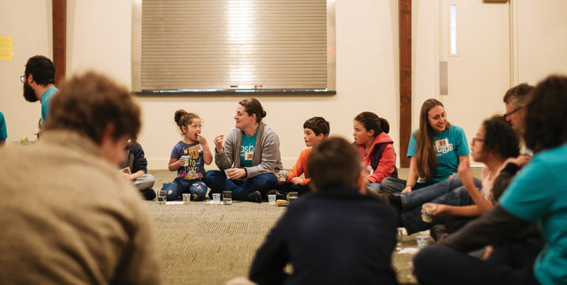 Snack time is a wonderful opportunity for Kids Club  volunteers to interact with the kids and show God's love. Photo courtesy of Seth Crissman