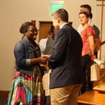 Oksana Kittrell is greeted and receives a gift from Aaron Kauffman