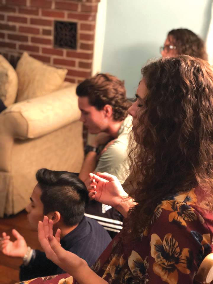 College students at a prayer and  worship service of Eastside College, a discipleship ministry of worker Rachel  Yoder. Photo: Rachel Yoder