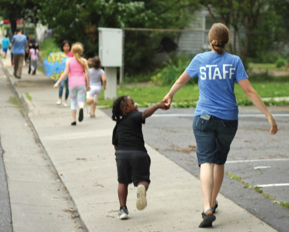 Melody Zimmerman walks with a child at a Harrisonburg, Va., Kids Club. Kids Clubs have reached hundreds of children and families in the Shenandoah Valley. VMMissions photo