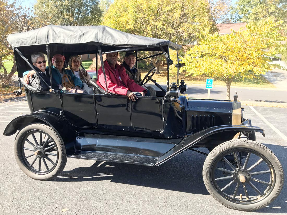 Margaret Keeler, Christine Poonsammy, Earlene Horst, and Deolal Ramdial ride in the Model T. (Photo: Aaron Kauffman)