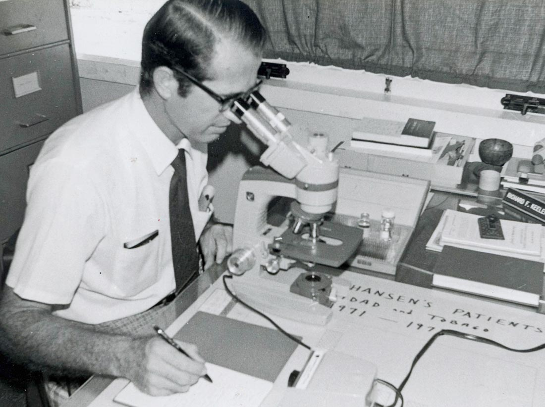Richard Keeler examines samples as he works with Hansen's Disease patients in Trinidad. Photo: VMC Archives