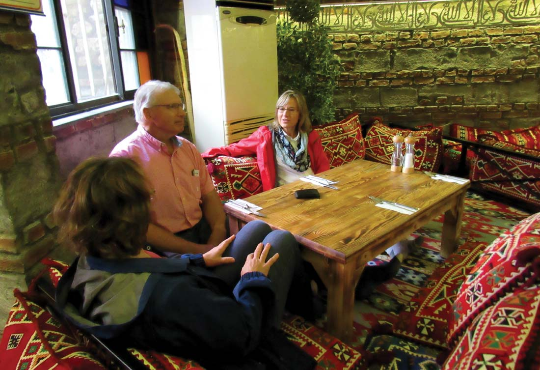 Lynn Suter (right), VMMissions Director of Operations, talks with Jewel and Dave Yutzy, owners of a Broadway, Va., agriculture business, about possible ventures during a trip to Eastern Europe. Courtesy photo