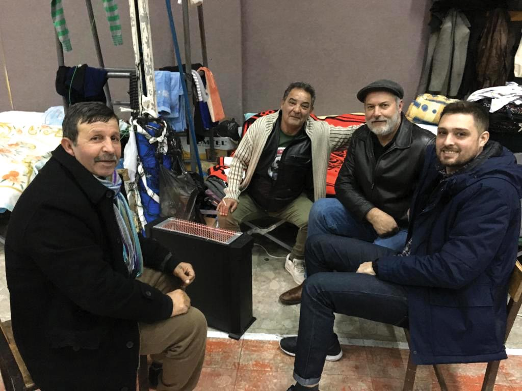 In the temporary shelter in Lezhë (left to right) locals Brahan and Petrit speak with VMMissions workers Dan Hess and Rafael Tartari. Photos courtesy of Rafael Tartari
