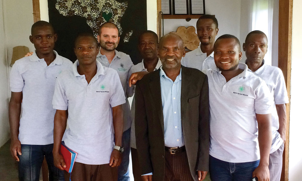 Employees of World Harvest Mission after a Bible study: (from left) Happy Michael, Mugisa, Brent Justice, Kapu,  Kisembo Akleo, Kadema, Ahebwa Johnson, and Tibesigwa. Photo courtesy of Brent Justice