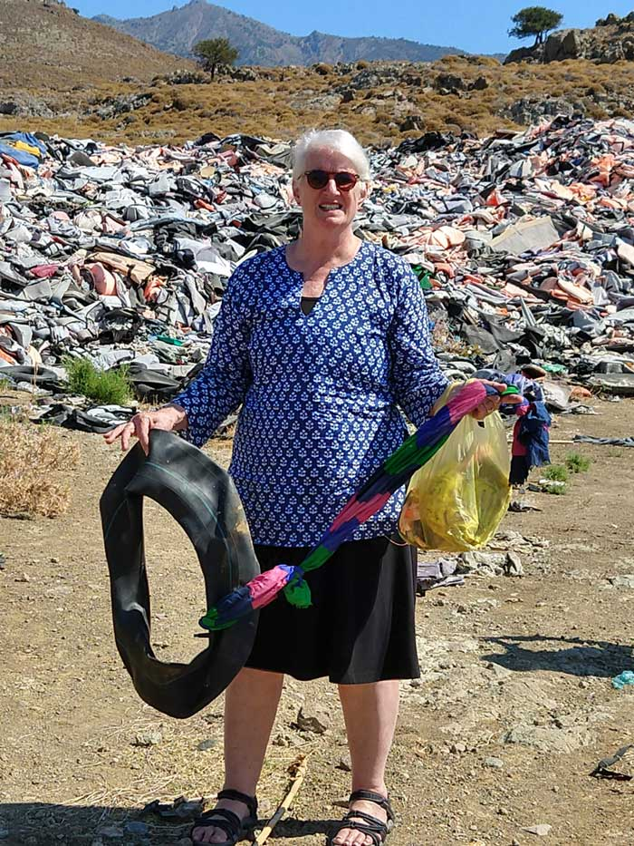 The author with a scarf she found tied to an inner tube in the junk heap. What story would these items tell?