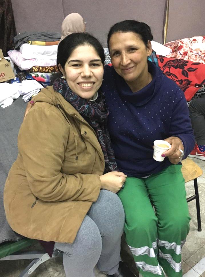 Solange Tartari with Rudina, a neighbor in the shelter.