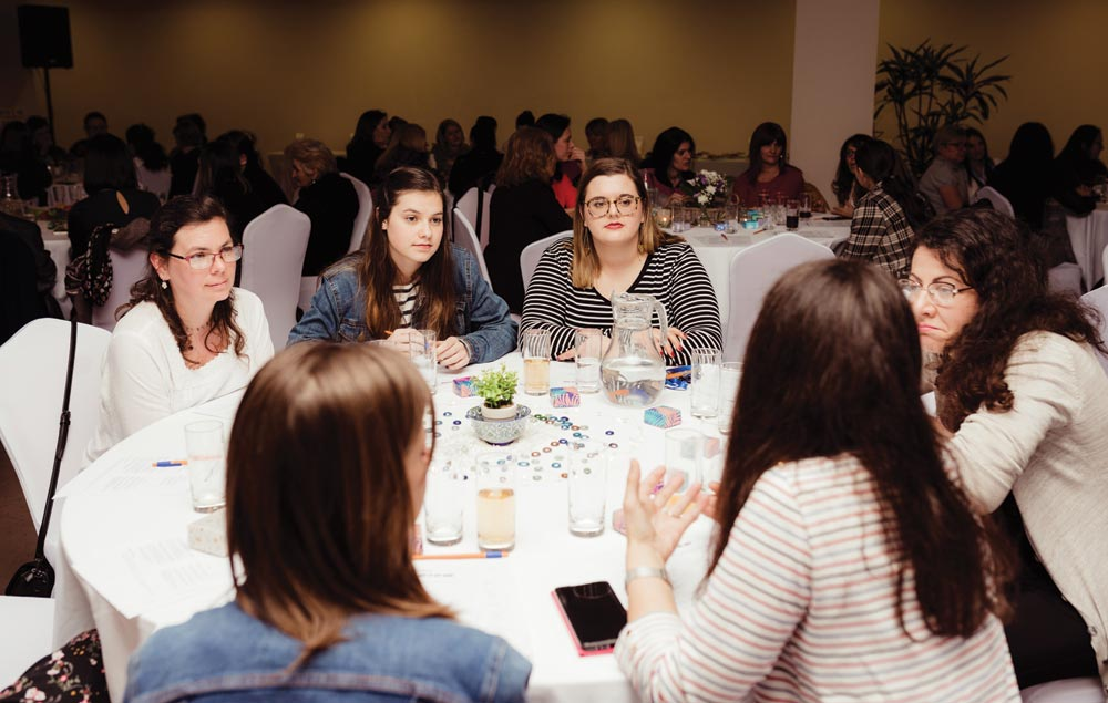 Laura (left) and women at her table discuss how their identities as women have been formed. Photo: Martina Petkovski