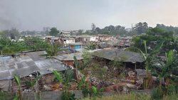 A view from a nearby highway of the community where Yugo and Grace serve.
